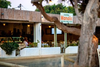 manolis tavern sign